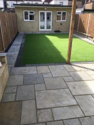 New with Indian sandstone patio with Artificial lawn