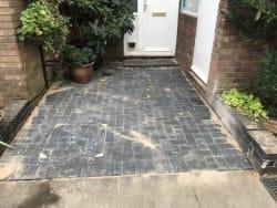 Charcoal marshal block paving.