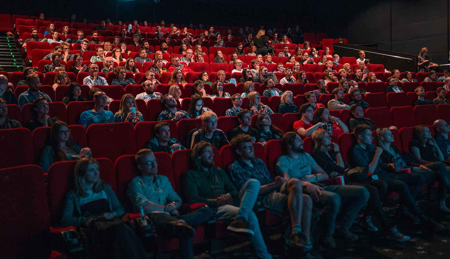 Image shows a crowd of people at the cinemas