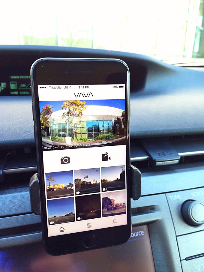 Clip the VAVA Dash Cam phone mount to any air vent