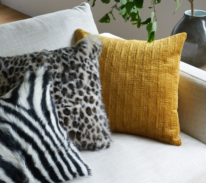 Using patterns and solid colours at home with cushion covers