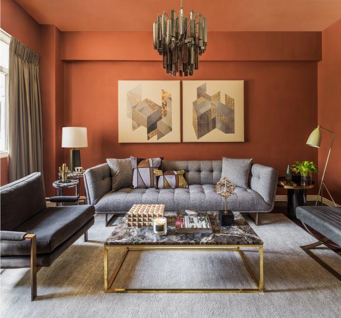 Grey living room furniture with orange walls