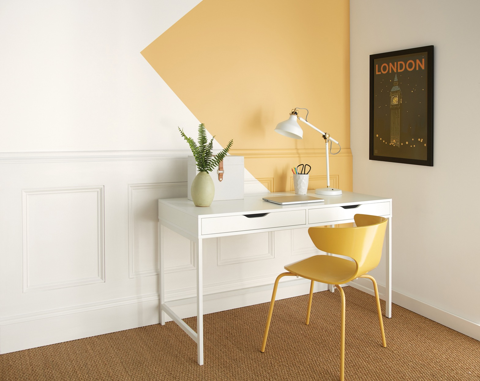 A splash of yellor for a mini home office | Source: marthastewart.com