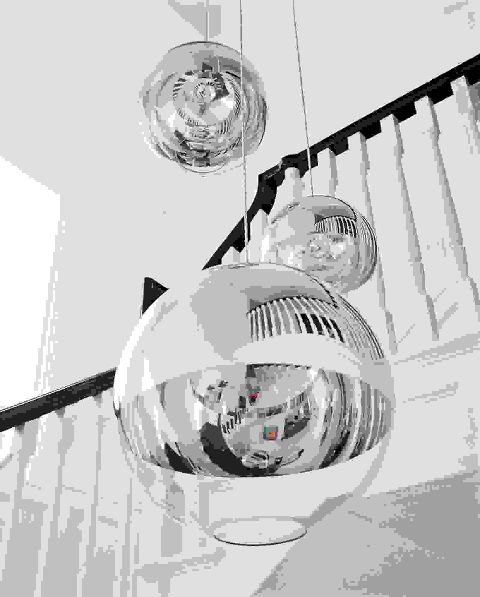 Futuristic orb chandelier by Tom Dixon | Source: vogue.com