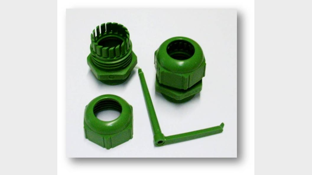 Cable gland fabricated with a biopolymer.