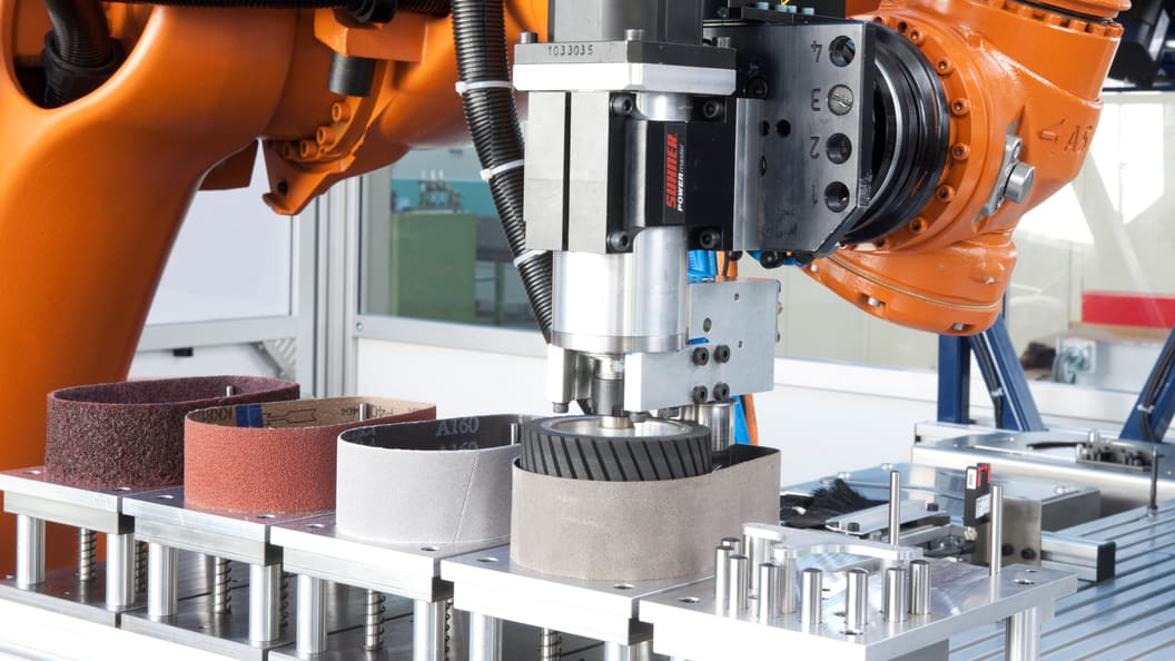 Automated grinding belt changer