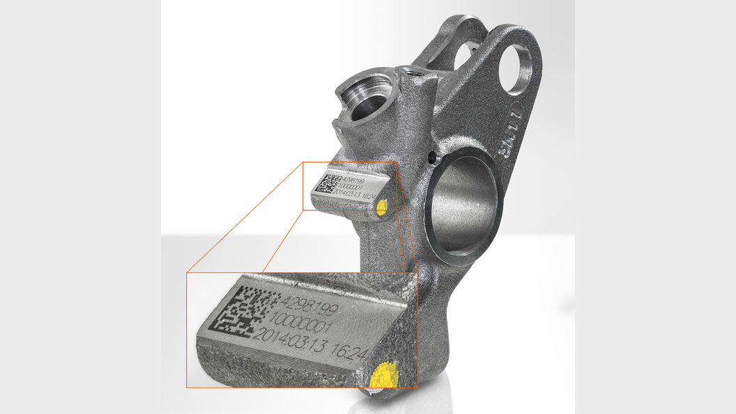 The rocker arm for a Jacobs Vehicle Systems engine brake is marked with a traceability code.