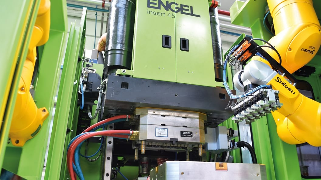 Fully automated production of an insert moulded automotive part.