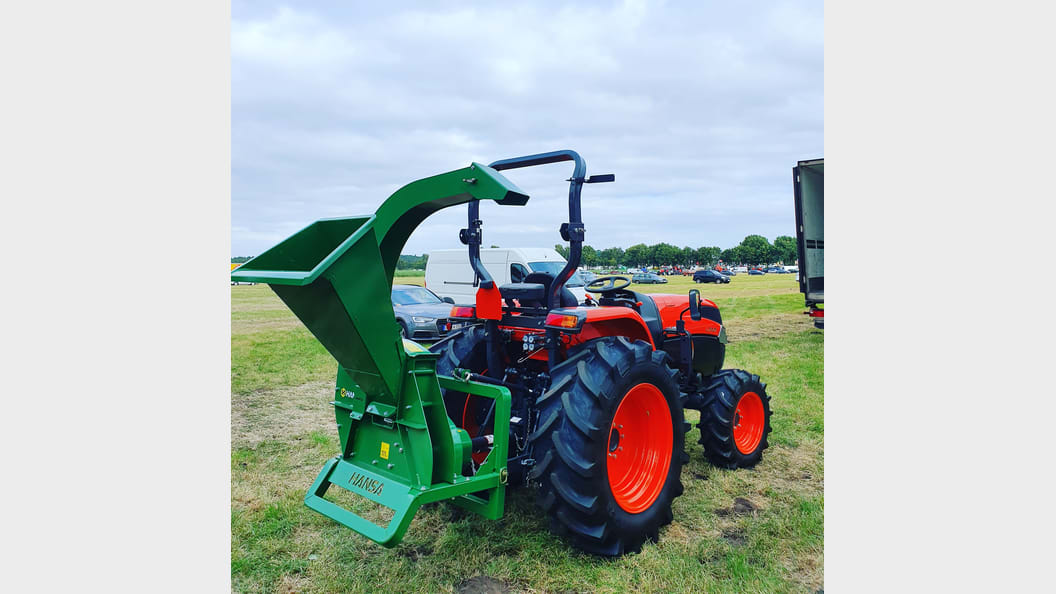 The HANSA C21PTO hitched to a Kubota Tractor