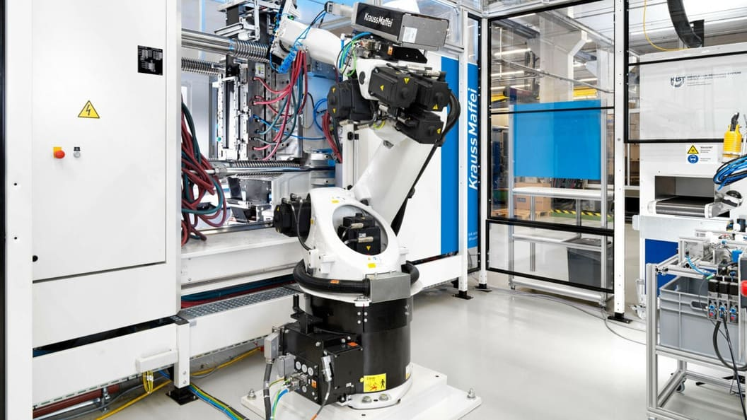 The articulated arm robot removes the panels and feeds the components into the UV tunnel