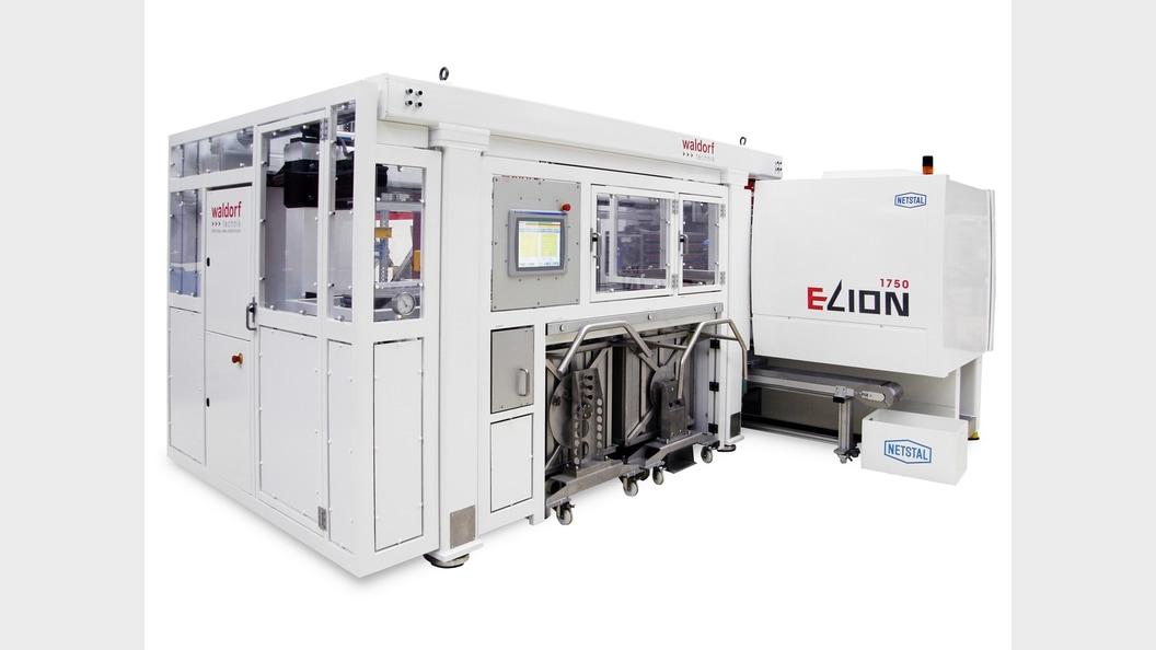 Produktionssystem mit Spritzgiessmaschine und Automationszelle