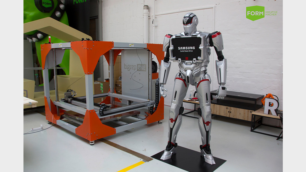 """The finished robot next to its """"creator"""", the BigRep ONE."""