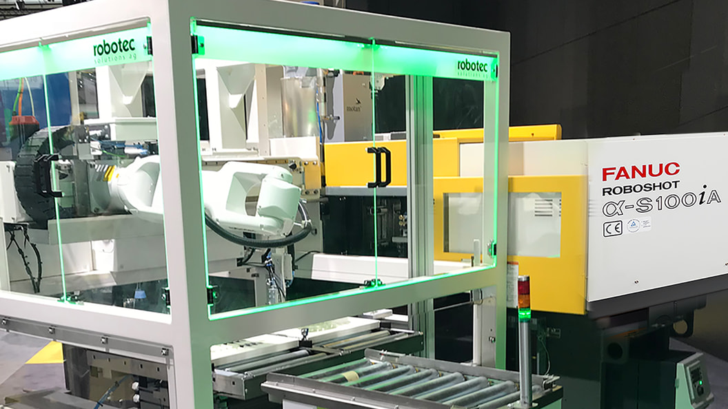 Fully automatic removal and assembly of parts from a ROBOSHOT machine with a FANUC robot