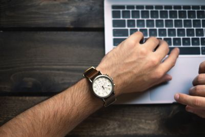 'Man in a watch typing' by Brad Neathery on Unsplash