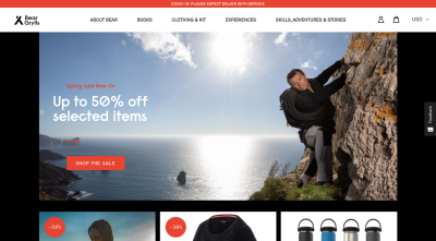Bear Grylls website with adventure nature imagery, strong black and red accents