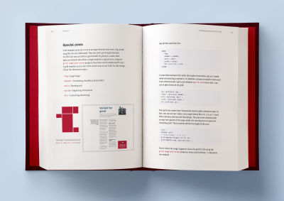 A hardcover book laying open on a light blue background, with two pages open that are showing some artwork examples of Bond conference and Medium Memberships