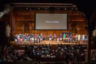 Students onstage during a CS50 programming lecture at Harvard