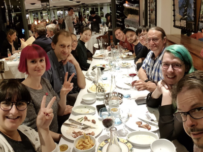 The Samsung group posing for an after-dinner picture around the table