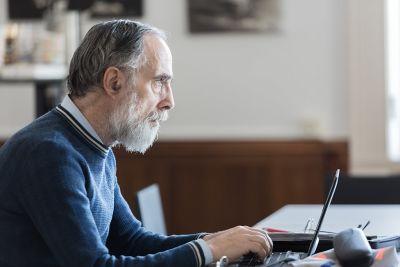 Older man using computer