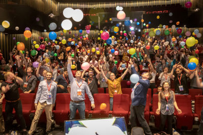 Audience members throwing balloons