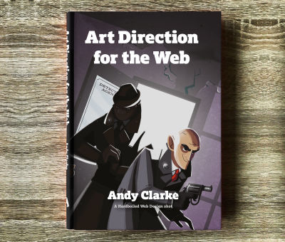 """A hardcover book laying on a wooden floor, called """"Art Direction for the Web"""""""