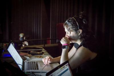 A photo of Amanda at a desk at the conference