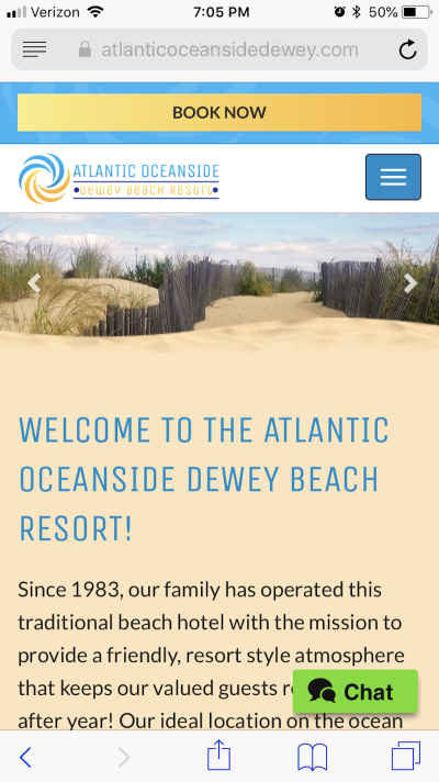"""The top of the Atlantic Oceanside page displays a """"Book Now"""" button."""