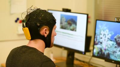 An EEG measurement device designed similar to a swim cap