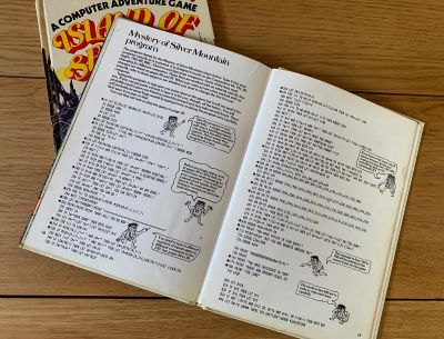 A book with lines of code intending to be typed out to make a text game