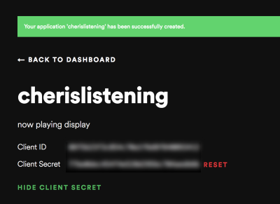 A screenshot of the client ID and client secret tokens in Spotify's dashboard - the client ID and client secret have been blurred out