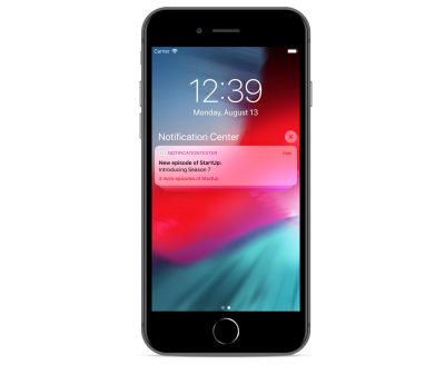 iPhone 8 Plus lock screen shown with a grouped notification stack from Notification Tester app.