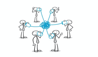 Stick figures of people talking to each other between a tangled mess of cables