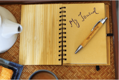 Picture of a journal notebook and pen