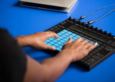 Man touching Ableton Push device
