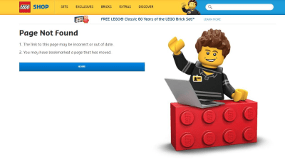 smiling LEGO figure behind a LEGO block with a computer