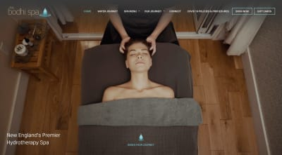 Bodhi Spa website - woman receives deep neck and head massage