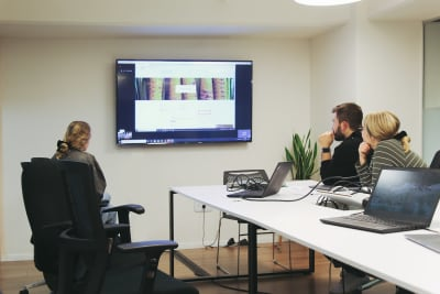 Three people remotely observing the usability session from a conference room
