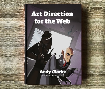"A hardcover book laying on a wooden floor, called ""Art Direction for the Web"""