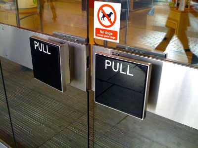 Example of doors that are technically accessible, but not usable