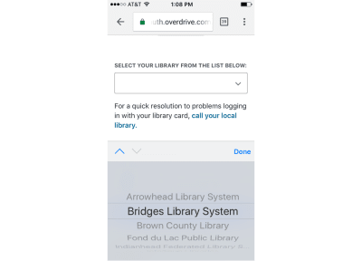 Pressing on the down arrow to find out more details on how to log into Wisconsin's digital library