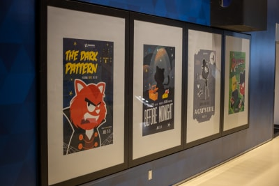 Photo of movie-style posters featuring the Smashing Cat