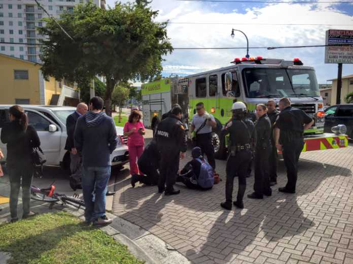 sweetwater poilce and miami dade fire crews assist an fiu student struck by a motorist january 2016