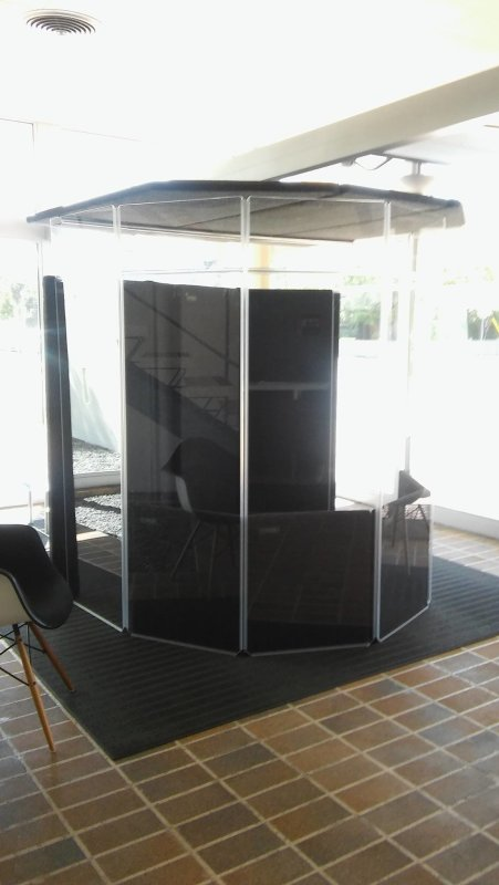What is this new contraption assembled in the Becket building lobby you ask? It's the new CES translation booth we'll be using for events. One or two people will sit inside to translate for our event guests, who will then hear them from the audience through their headsets.