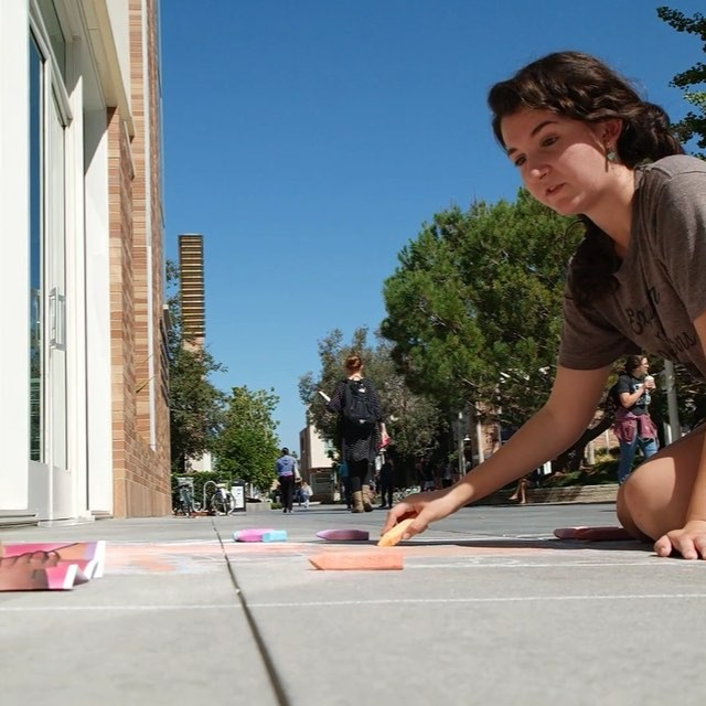 Photo: Sophomore Caitlin Duffy is using chalk art to show what The Chapman...