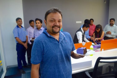 Yahoo team member enjoy their onboaring cake at our coworking space in Golf Course Road, Gurgaon