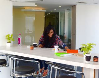 A member has a happy time in the lounge of our Business Centre in Sohna Road, Gurgaon
