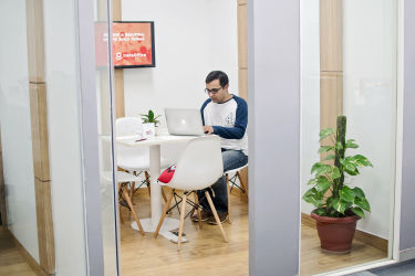 Our cofounder Vikas Lakhani working from meeting room in coworking space in Golf Course road in sector-32