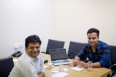 Our cofounder Devendra in a maeeting in our business centre in Sohna Road, Gurgaon