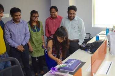 Yahoo team cuts their onboarding cake on their first day in office