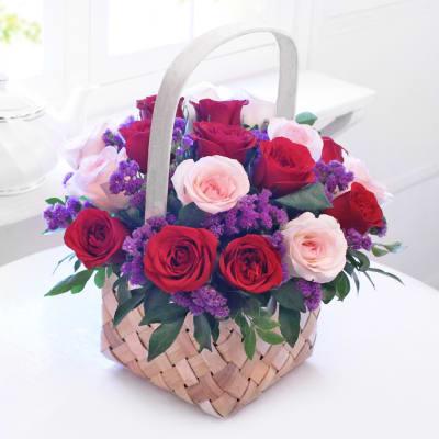 Red flowers send red flower bouquets red roses online in india elegant blush basket arrangement mightylinksfo Gallery